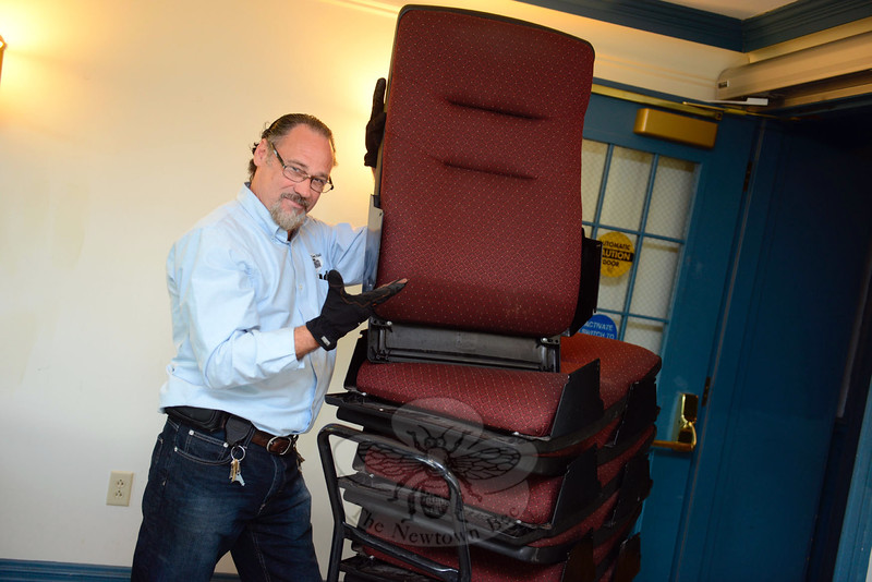 Edmond Town Hall staff member Joe Collins on Wednesday, May 13, received a delivery of new theater seating to replace balcony seats that were original to the building. (Bobowick photo)