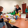 Volunteers worked to sort donations by 2 pm on Saturday, May 9, that had been brought to the Salvation Army Food Pantry at Newtown Social Services through the 23 Annual Letter Carriers Food Drive, which asked residents to leave study bags of nonperishable food items by their mailbox for volunteers to collect on Saturday. Newtown Social Services Director Ann Piccini, center, explained where items should be sorted to Kristen Kennen, left, and Julia Preszler, who both arrived to help as representatives from Girl Scout Troop 50763. (Hallabeck photo)