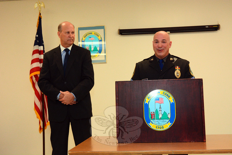 Police Sergeant Scott Ruszczyk, right, speaks on May 1, as Police Chief Michael Kehoe looks on after Mr Ruszczyk was sworn into office as a sergeant in ceremonies at Town Hall South. (Gorosko photo)