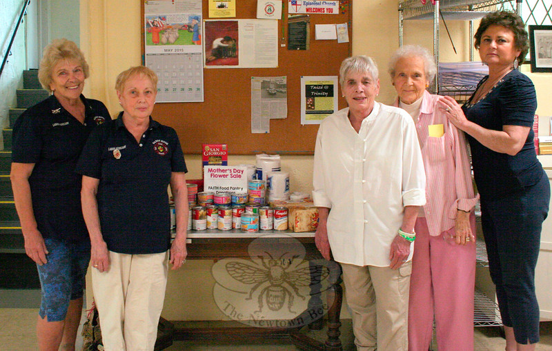 The Sandy Hook Volunteer Fire & Rescue Ladies Auxiliary recently presented its annual Mother's Day Flower Sale. During the May 8–9 event, the group also asked customers to consider bringing a donation for FAITH Food Pantry with them to the fire company's main station. On Tuesday, May 12, Auxiliary members Joyce Staudinger, left, and Carol Lockwood, second from left, delivered canned goods, pasta, and toiletries to the nonecumenical pantry located within St John's Episcopal Church. Accepting the donation on behalf of the volunteers who were spending time at the pantry that morning were, continuing to the right, FAITH Co-Chair Lee Paulsen, and regular volunteers Louise Andrews and Patricia Murray. The pantry is open to receive donations, or help residents who need a hand putting food on their table, on Tuesdays from 10 am until noon and Thursdays between 6 and 7:30 pm. (Hicks photo)
