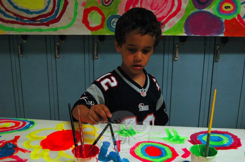 Sandy Hook School student Nate Wilford tried his hand at painting at one of the activity stations set up during the school's Student Art Show on May 7. (Hallabeck photo)