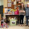 """Kayla O'Sullivan, left, and Lauren King, at right, visited FAITH Food Pantry on May 15 to deliver a large donation of nonperishables and toiletries they had collected in recent weeks. On May 2, the girls set up a table outside Dunkin' Donuts on Queen Street, and in about two hours received $100 in donations. Then on May 9, the girls set up boxes at Newtown Middle School during Newtown Babe Ruth Picture Day. Kayla said watching her older brother do collections for the food pantry a few years ago made an impression on her. """"I came when they dropped everything off, and saw what a difference it makes,"""" she said Friday afternoon. FAITH Co-Chair Lee Paulsen, center, told the girls she was so proud of them. """"There is a big different between thinking about doing something good, and doing it,"""" she said. """"I cannot thank you enough."""" (Hicks photo)"""