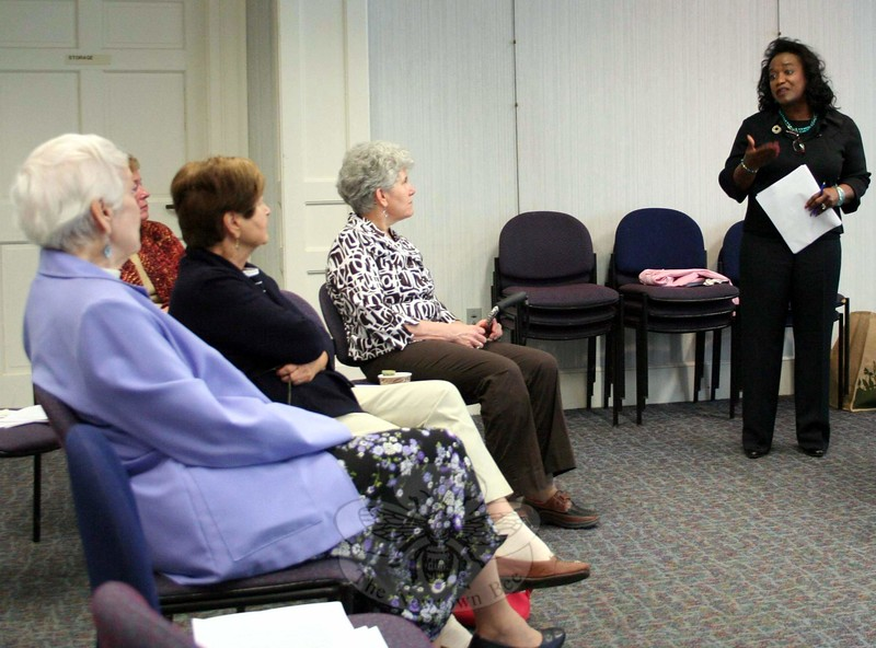 """Beverly Ruekberg, standing at right, responds to a question from one of the attendees of last weekend's Church Women United (CWU) May Friendship Day, held May 16 at C.H. Booth Library. Following a program suggested by the national CWU office, the Newtown unit celebrated nurses, aides and other caregivers with a program called """"Journey of The Caregiver."""" Members of the local unit helped to present the program, which included a welcome from Unit President Darlene Jackson, prayers, a call to worship and scripture readings. But it was Ms Ruekberg's presentation that was the core of the morning program. With a series of short videos queued by her husband, Ms Ruekberg shared stories of caregivers and their work. She encouraged those in attendance, when they need to serve as a caregiver to a loved one, to remember to take care of themselves while doing what they can for others who are ill. (Hicks photo)"""
