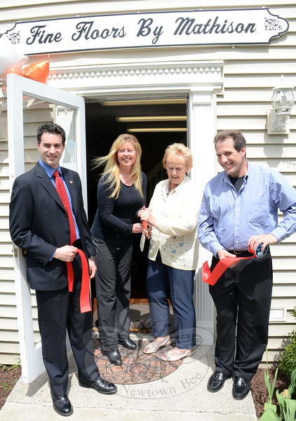 Tricia Mathison-Benvenuti, second from left, and Nick Sirianni, far right, are joined by First Selectman Pat Llodra and Economic Development Commissioner Matt Mihalcik May 13 for a ribbon-cutting celebrating the recent opening of Fine Floors By Mathison at 85 South Main Street. The store can facilitate the sale and/or installation of a wide variety of carpet, vinyl, ceramic tile, unfinished and prefinished hardwood, as well as area rugs and runners from major brands to suit every budget. (Voket photo)