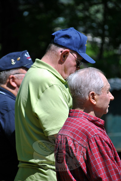 Robert Qubick, Marine veteran of Korea; Michael McKenney, US Army veteran of the Vietnam; and Donn Clark, US Army veteran of Vietnam, stand and are recognized, along with other veterans, at the VFW Memorial Day ceremony, Monday, May 25. (Crevier photo)