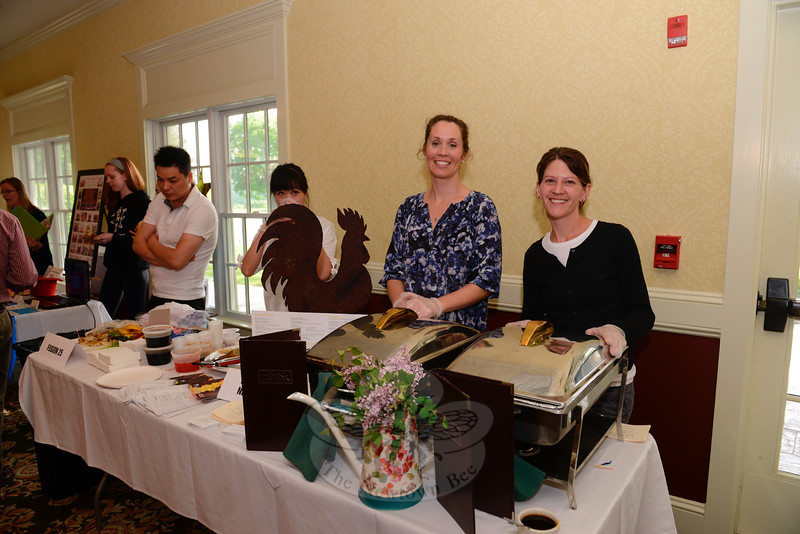 Susan Anzalone and Kathy Appling from The Inn at Newtown served samples from the Inn's menu at Destination Newtown, an annual business showcase presented by the local Chamber of Commerce, held on May 20. (Bobowick photo)