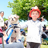 Brighton Karvoski took a moment to visit with Sprout, a Newtown Strong therapy dog in training. Sprout sat with his owner Dee Davis Saturday, May 23, during the annual Great Pootatuck Duck Race, hosted by the Lions Club. (Bobowick photo)
