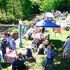 Guests attending the duck race Saturday enjoyed the sunny afternoon shade on the sidewalk border-ing the Pootatuck River. (Bobowick photo)
