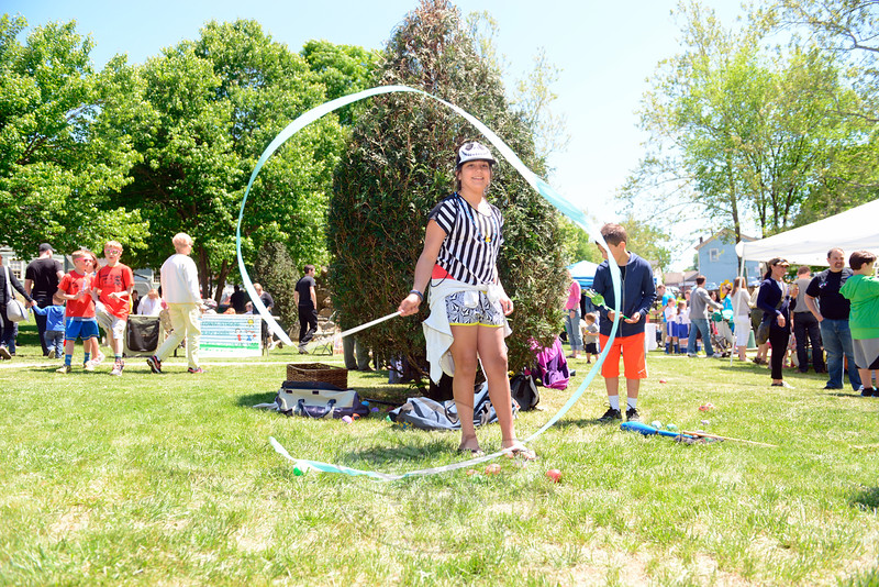 Haly Quesenberry twirled a length of ribbon and danced on the grass at 5 Glen Road Saturday, May 23, during the annual Great Pootatuck Duck Race, hosted by the Lions Club.. (Bobowick photo)