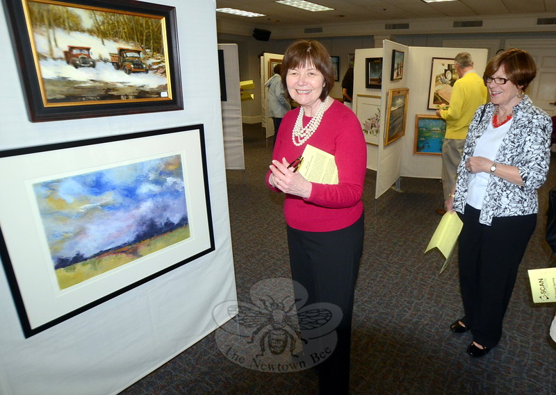 On May 3, a reception marking the opening of the 45th Annual SCAN Spring Juried Art Show & Sale was held in the Community Room at C.H. Booth Library. Among the artists and admirers in attendance  was Roberta Shea, left, who was surprised to see her friend Arline Corcoran, who came in from Danbury to support the cause. (Voket photo)