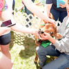 Diane Paproski of Castle Hill Farm had a 4-day-old calf with her at the 8th Annual Earth Day Festival. The bright-eyed baby animal drew guests who all wanted to pet the soft, newborn fur. (Bobowick photo)