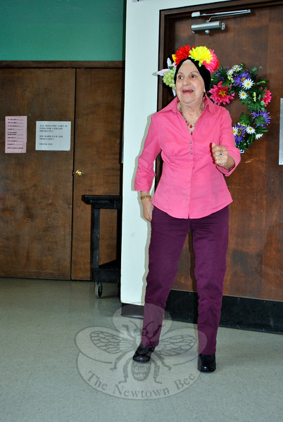 "Senior Center member Connie Sciglimpaglia presents Carmen Miranda's ""Chicka-Boom-Boom"" to her fellow center members at the May 6 Mother's Day Tea. (Crevier photo)"