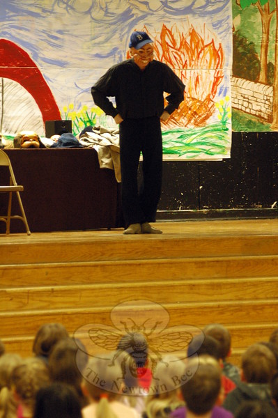 "Larry J. Hunt of the Masque Theatre Company presented a number of masks and information about the different types of masks during an assembly at Head O' Meadow Elementary School on Friday, April 24. ""People like us have been making masks all throughout history,"" Mr Hunt told the students seated in the school's cafetorium, after sharing a few different masks at the start of the performance. More information about the Masque Theatre Company is available at masque-theatre.org. (Hallabeck photo)"