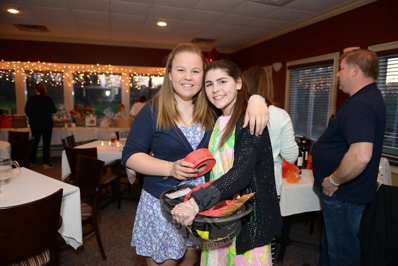 Selling raffle tickets during a wine tasting fundraiser— which also included a silent auction and raffles, with proceeds benefiting the Newtown Hook & Ladder Co #1 Building Fund— throughout the night were friends Maddie Salvesen and Kristin Cole. (Bobowick photo)