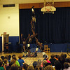 Members of the Zuzu African Acrobats group performed a balancing act as one of its many feats during an assembly performance at Middle Gate Elementary School on Tuesday, April 28, which was sponsored by the school's PTA. (Hallabeck photo)