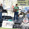 The Neverland String Band — from left, Bill Burton, Cadence Carroll, and young Jessup Burton — performed during the Earth Day Festival last weekend. A steady lineup of entertainment was one of the offerings during the eighth annual event presented on the front lawn of Newtown Middle School. (Hutchison photo)