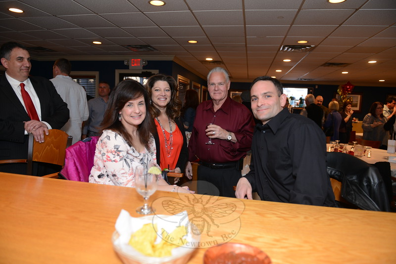 Elaine Corbo and her husband, Hook & Ladder Fire Chief Ray Corbo, left and right, enjoy a cocktail with Sandy Hook Fire Chief Bill Halstead and his wife and Town Clerk Debbie Aurelia Halstead during a wine tasting fundraiser, which also included a silent auction and raffles, with proceeds benefiting the Newtown Hook & Ladder Co #1 Building Fund. (Bobowick photo)