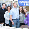 Stonehollow Fine Home Inspection hosted a pinecone birdfeeder-making tent at the 8th Annual Newtown Earth Day Festival on Saturday, May 2.. Pictured are members of the Horn family, which helped residents make natural feeders, from left: Ryan, Susan, Jason, and Natalie Horn, along with Shannon Jackman. (Hutchison photo)