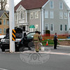 At about 4:30 pm on May 3, motorist Elizabeth Wolf, 48, of Redding, who was driving a 2012 Honda Pilot SUV, was waiting at a stop sign on westbound Church Hill Road in preparing to make a left turn onto southbound Main Street, police said. In attempting that turn, the vehicle then drove into the 100-foot-tall flagpole that stands at the intersection, police said. Both Wolf and a passenger reported neck pain, but refused transport to a hospital, police said. The Newtown Volunteer Ambulance Corps and Hook & Ladder volunteer firefighters responded to the accident. Police said they issued Wolf a written warning for making a restricted turn. (Hicks photo)