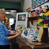 Connie Sciglimpaglia and Claire Theune exclaim over Senior Center Director Marilyn Place's collection of teapots. (Crevier photo)