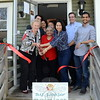 The new B.U. Juice Bar recently celebrated its grand opening adjacent to the laundromat in the plaza behind 100 Church Hill Road in Sandy Hook center. Joining the festivities are, from left, First Selectman Pat Llodra, town Economic Development official Matthew Mihalcik, Dipti Bhatt, store owner Diana Arias, and Newtown Chamber of Commerce President Tim Haas, as well as several other family members including Upendia Bhatt, Ruth Pina, and Deb Patel. (Voket photo)