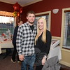 Steven Clark and girlfriend Layla Longo were among those checking out the silent auction items Saturday. The couple was out to support Hook & Ladder's Building Fund efforts. Mr Clark is an engineer with Sandy Hook Volunteer Fire & Rescue. (Bobowick photo)