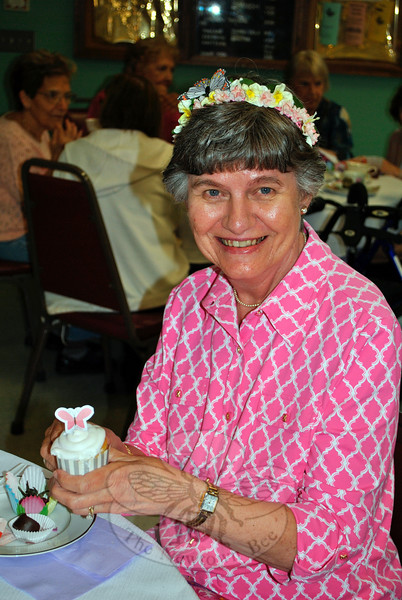 Paula Catalano enjoys a cupcake at the Senior Center Mother's Day Tea, Wednesday, May 6. (Crevier photo)