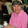Paula Catalano enjoys a cupcake at the Senior Center Mother's Day Tea, Wednesday, May 6. (Crevier photo)