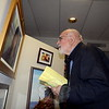 On May 3, a reception marking the opening of the 45th Annual SCAN Spring Juried Art Show & Sale was held in the Community Room at C.H. Booth Library. Among the artists and admirers in attendance was Bethel artist Vito Gesualdi, who appears entranced by a fellow artist's entry. The show and art sale continues through May 10.