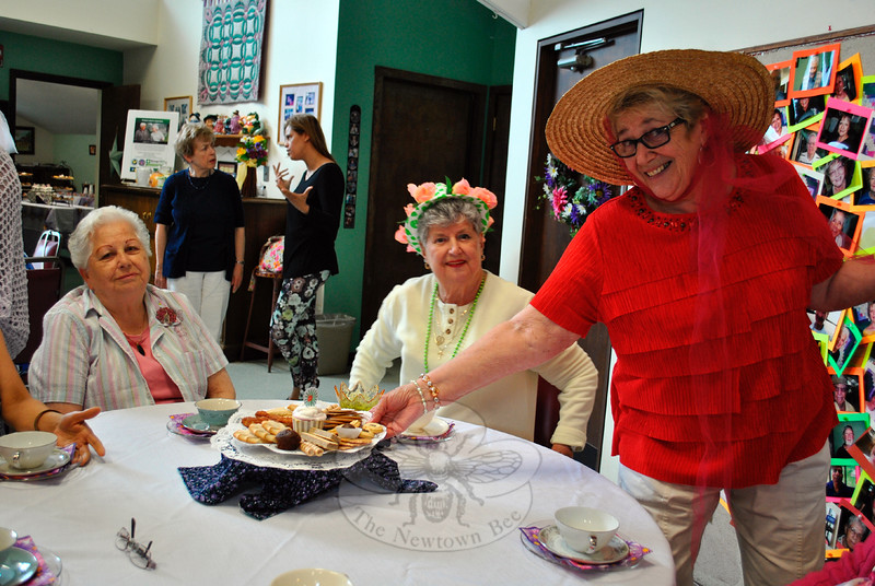 Karin Aurelia serves a tray of tea cookies to Rose Cipolla and Luellen Dwyer's table, along with a big smile. (Crevier photo)