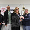 The Sandy Hook Volunteer Fire & Rescue Ladies Auxiliary recently made a donation to The Newtown Fund's Holiday Basket Program. Ladies Auxiliary Treasurer Janice Butler, third from right, presented a check on behalf of the group to Linda Bates, president of The Newtown Fund, on November 10. Also in the photo, from left, are LA members Shari O'Reilly, Sue Shpunt, and Kelly Richardson, Newtown Fund board member Jim Solomon, and LA members Joyce Staudinger and Rebecca Ritter. (Hicks photo)