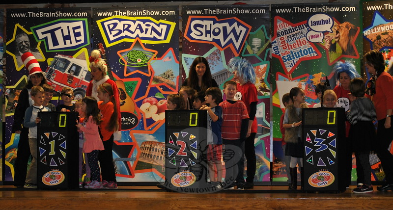 From left, teachers Ms Kuligowski (Cat In The Hat) and Ms Iorfino (Cindy Lou Who), join HOM students Noel McLeod, Brayden Kozek, Angela DiLorenzo, Tamzen Spaleta, Ava Geiger, and Sonya Feder; Ms Dreger and Ms Divert (Thing 2) join June Cash, Giancarlo Rivera, Tristan Zoto, Kory Briganti; and Ms Keith (Thing 1) and Mrs Washicko join Ellie Garbowski and Blake Heim-Sherwood in putting their heads together to answer curriculum based questions during The Brain Game. (Crevier photo)