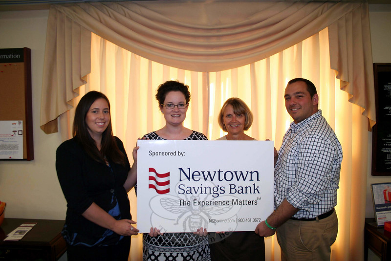 The 29th Annual Newtown Holiday Festival, a benefit for Newtown Youth & Family Services spon-sored by Newtown Savings Bank, is just a few weekends away. Planning is in full swing for this year's event, which will primarily take place at Edmond Town Hall. From left is Kaitlyn Johnson, community coordinator for NYFS; Katie Smith, branch manager for Newtown Savings Bank's main branch at 39 Main Street; Maureen Birden, a mortgage banker for Newtown Savings; and Matt Ariniello, NYFS operations assistant. Ms Smith and Ms Birden are also co-chairs of the Holiday Tea, one of the longstanding (but recently renamed) offerings of the festival. (Hicks photo)