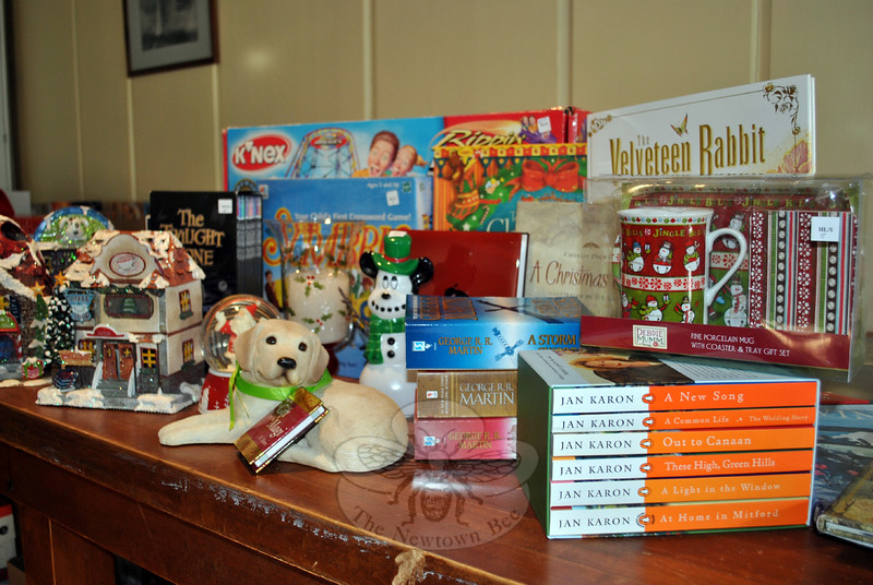 There will be something for everyone at the Friends of the C.H. Booth Library Annual Holiday Book Sale, organizers prove with this display of just a fraction of items to be sold at the December 5 and 6 sale. (Crevier photo)
