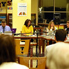 Board of Education Vice Chair Laura Roche, center, was highlighted for her accomplishments in her tenure on the board during her last regular board meeting on November 4. School board member Debbie Leidlein, right speaking, was one of many board members who offered their appreciation during the meeting. (Hallabeck photo)