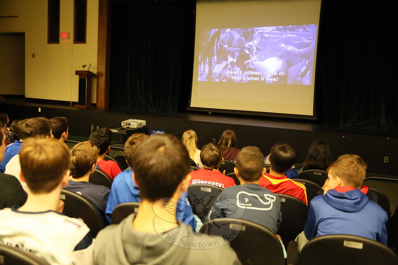 Inside Newtown Middle School's auditorium during a lunch wave on Monday, November 16, students watched the 2002 film Pinocchio in Italian. (Hallabeck photo)