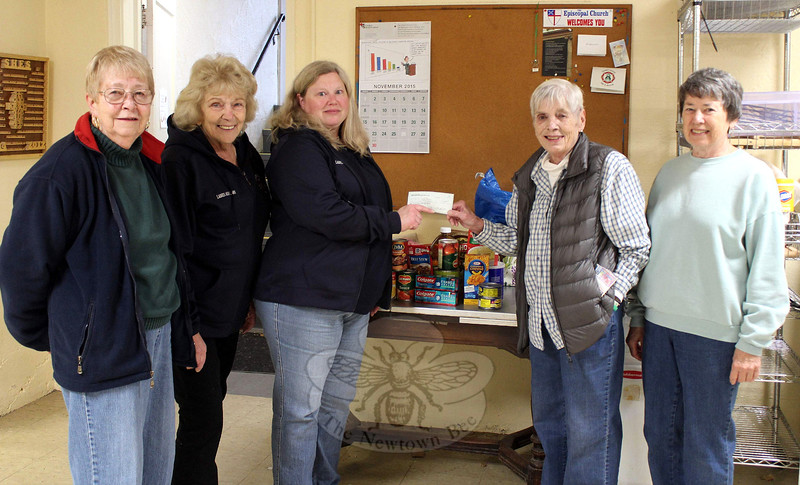 Members of the Sandy Hook Volunteer Fire & Rescue Company Ladies Auxiliary visited FAITH Food Pantry on November 10 with a pair of donations. The first was a financial donation for the pantry. The second was a donation of food and other items that had been given to the auxiliary for the pantry during the recent Sandy Hook Halloween Walk. Representing the ladies auxiliary were, from left, members Judi Richardson and Joyce Staudinger, and Treasurer Janice Butler. Ms Butler presented a check on behalf of the auxiliary to FAITH Director Lee Paulsen, who was joined by volunteer Barb Lesko. The Sandy Hook Ladies Auxiliary will be joining members of all of Newtown's companies this weekend for the annual Fill The Fire Truck collection, which will also benefit FAITH. (Hicks photo)