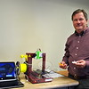 Scott Larsen holds a client's original wax model and the first of three prototypes he made using the library's smaller Afinia 3D printer. (Crevier photo)