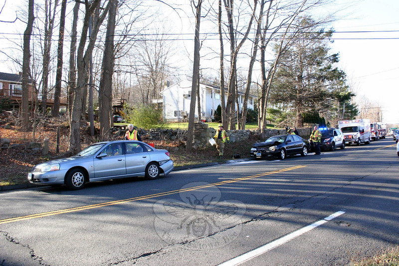 Main Street at its intersection with Prospect Drive and Pecks Lane at about 1:34 pm on November 18. In the incident, motorist Christopher Puleo, 21, who was driving a 2003 Acura sedan, struck the rear end of a 2003 Saturn sedan driven by motorist Christopher Kelly, 38, police said. Puleo received an infraction for failure to drive a reasonable distance apart, police said. (Hicks photo)