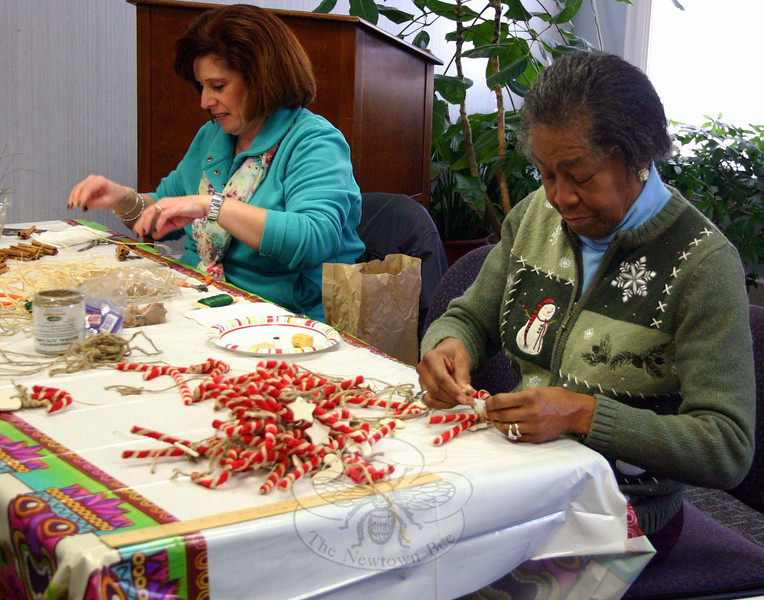 Members of The Garden Club of Newtown held one of their first workshops for the annual Greens Sale on November 18. Many ladies created ornaments that will be used to decorate fresh evergreen wreaths that will be sold on December 6. (Hicks photo)