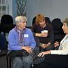 INGRID MEIER, CHRIS DURAN, ELLYN GEHRETT<br /> From left, MOW volunteers Ingrid Meier, her daughter Chris Duran, and Ellyn Gehrett share stories at the MOW 40th birthday celebration. (Crevier photo)