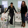 Women Involved in Newtown (WIN) spent the better part of last Friday in the gathering hall of Newtown United Methodist Church. It was delivery time for the annual WIN Thanksgiving Baskets program, and this year 80 Newtown families benefited from the group's efforts. Mandy Monaco (left) and Cyndy DaSilva stand between two chairs that were later piled with donations. (Hicks photo)