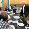 Kent McCoy, principal at Smith Edwards McCoy Architects, reviews plans for the Newtown High School auditorium project with the Public Building and Site Commission November 24. The major renovation will encompass handicapped, theatrical, HVAC, ceiling, and back stage elements of the facility, which commission Chairman Robert Mitchell believes will deliver a college-level performance space. Director of Music Michelle Hiscavich, far right, was in attendance for the review. (Voket photo)