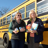Workers for All-Star Transportation, which provides student transportation for local schools, collected food for the needy on November 21 in front of the Stop & Shop supermarket at Sand Hill Plaza. All-Star donated the food items collected to the food pantry at the town's Social Services Department. Holding some food items are All-Star workers Liz Parsons, left, and Diane McIlrath. (Gorosko photo)