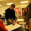 Newtown High School senior David Anderson demonstrated how to cut a pepper during Career Day at Newtown Middle School on Friday, November 13. David assisted NHS culinary teacher Brian Neumeyer's presentation. (Hallabeck photo)