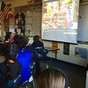 Sixth grade students in Maura Drabik and Todd Stentiford's cluster watched a video on YouTube that shared photos of festival celebrations from around the world. (Hallabeck photo)