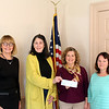 "Newtown Visiting Nurses Association (VNA) made a donation on November 3 to Bethel VNA. The donation will allow the Bethel group to continue administering a program called Know Your Numbers for staff members in the Newtown Public Schools system. The multistep program helps participants keep track of their blood sugar, cholesterol, and other health-related figures. ""This helps people take control of their health,"" said Donna Culbert, a member of Newtown VNA and director of the local Health District. ""It's a nice, organized effort in the school system, which has been appreciated by the staff,"" Ms Culbert told Newtown VNA members prior to the presentation. From left is Newtown VNA President Mary Tietjen and Treasurer Alice Falkowitz, presenting a check for $2,500 to Krista Stringer, community program coordinator for Bethel VNA; and Ms Culbert. Funding for the program initially came from Anthem, said Ms Culbert. The donation earlier this month will allow follow-up care to continue, she added. (Hicks photo)"