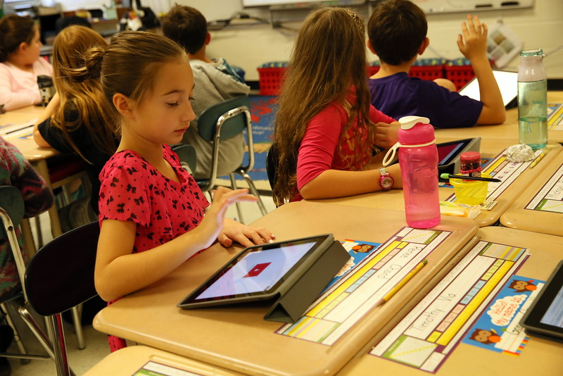 Middle Gate fourth grader Rene Chard worked on an iPad to answer questions for Ms Mauro's trivia game. (Hallabeck photo)