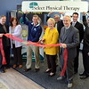 Newtown officials joined staff, supporters, and company representatives for a ribbon-cutting event at Select Physical Therapy at 12 Queen Street recently. Among those attending are, from left, company business development representative Brian Delp, staffer Amy Reyen, physical therapist Bob Strittman, First Selectman Pat Llodra, Robert Kensek, Dr Curtis Beck, EDC Commissioner Matt Mihalcik, and Select VP Mark Gombotz.  (Voket photo)