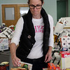 Women Involved in Newtown (WIN) spent the better part of last Friday in the gathering hall of Newtown United Methodist Church. It was delivery time for the annual WIN Thanksgiving Baskets program, and this year 80 Newtown families benefited from the group's efforts. Christine Crudo checks early donations to make sure they have not expired. (Hicks photo)